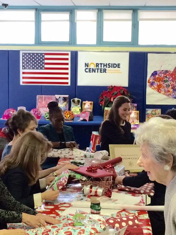 """British Consulate NY on Twitter: """"The Duchess of Cambridge helps volunteers wrap donated gifts at the Northside Center in Harlem. #RoyalVisitUSA http://t.co/9mNzYrNvc1"""""""