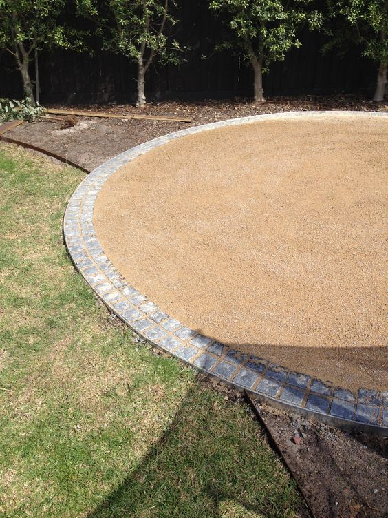 Walton house edging in with blue stone cobbles around the for Gravel around fire pit