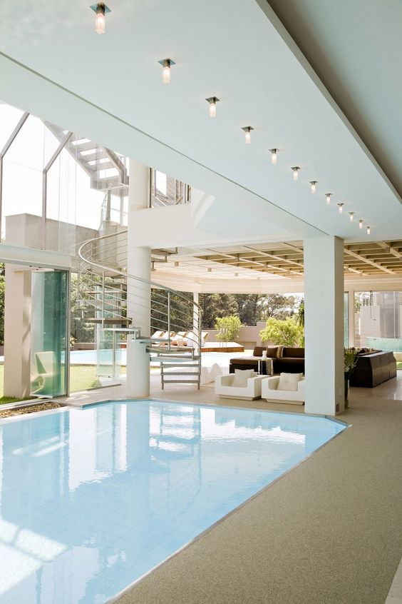gorgeous view of the indoor (and out in the background) pools of the Glass House by Nico Van Der Meulen Architects.  Check out the rest of the pictures, you won't be disappointed.