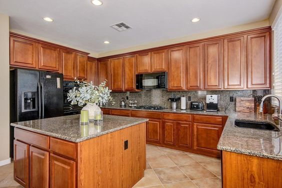 I love the granite matching on the counters island and matching