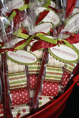 Little Hershey Bars wrapped in gift wrap and then bagged and tagged. Cute idea!