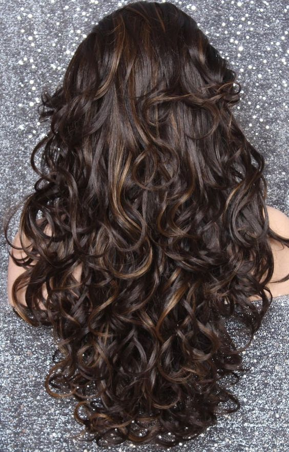 long layered haircuts 2021, with curls and bangs and side parting