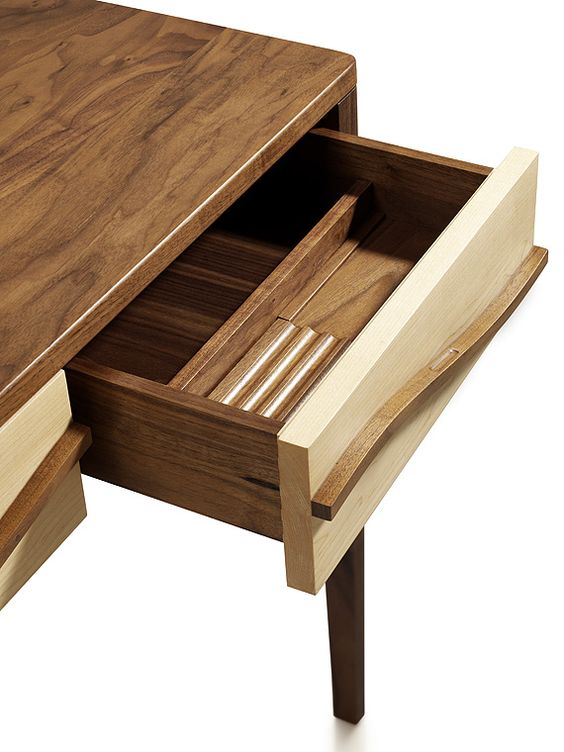 Joanna is an elegant but practical writing desk with three drawers. A Solid timber construction of american black walnut and maple. Available from Heliconia Furniture