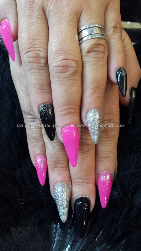 stiletto nails with pink black and silver nail art | Nueva ...