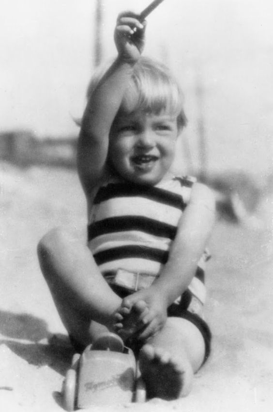 Norma Jeane on the beach of Santa Monica, 1928.