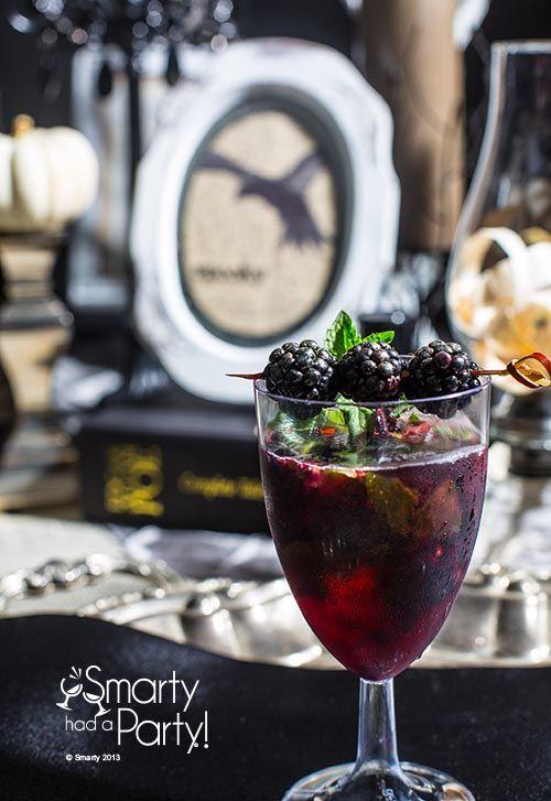 6 fresh blackberries     fresh mint leaves     1.5  fl oz. shot white rum     1/2 cup cranberry juice