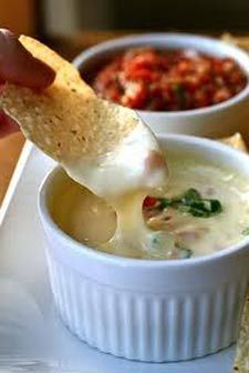 The secret to white queso dip @ Mexican restaurants: white American cheese!  3 ingredients, one crock pot.