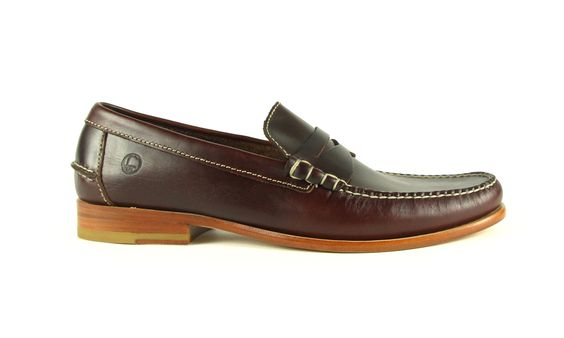 Make an easy choice for your wardrobe with this handsewn slip-on. Justin features a luxurious leather upper with classic loafer styling.