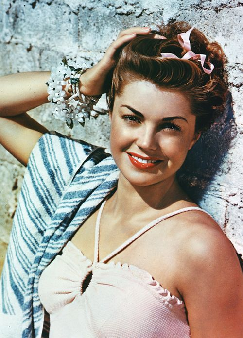 Esther Williams was a competitive swimming champion and actress who would have gone to the 1940 Olympics if World War II hadn't have cancelled them.