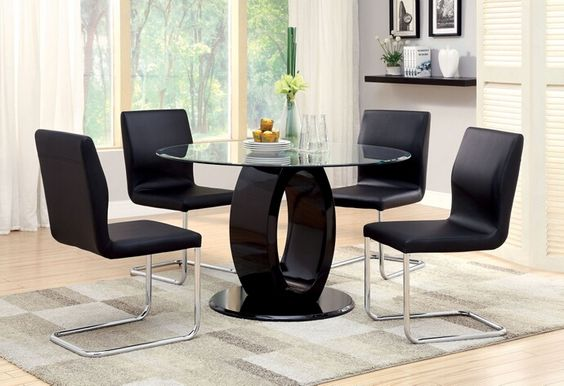 """5 pc Lodia I collection modern style black finish wood oval pedestal base dining set with round glass top. This set includes the table with 4 side chairs. Table measures 48"""" x 48"""" x 30"""" H. Side chair measures 17 1/4"""" x 21"""" x 35 1/2"""" H.   Some assembly required."""