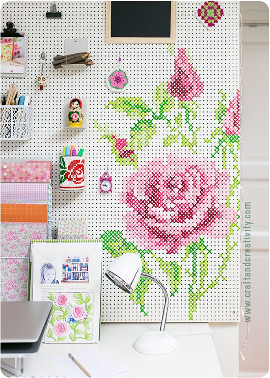 Genius!  I love the cross stitch pattern added to the pegboard. How I built and painted my pegboard - by Craft & Creativity: