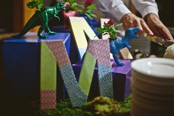 Dino Planters, light saber send offs, and much more. Beautifully geeky wedding.