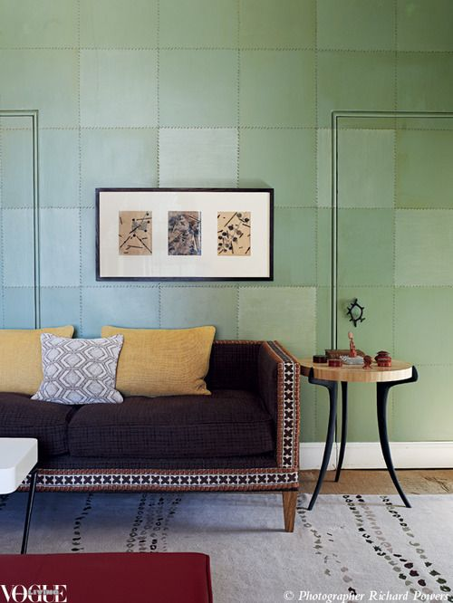 It's not wallpaper! Designer Ashley Hicks painted the walls in his sitting room to look like stitched together squares of green leather.