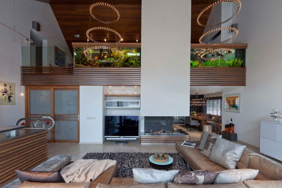 http://sandavy.com/mesmerizing-modern-interior-concepts-for-family-dwelling-design/inspiring-modern-home-right-side-of-fireplace-hood-looks-great-beautiful-aquarium-placed-in-the-left-stylish-livingroom-concept-decorated-wide-led-television-wooden-fireplace-unique-carpet-cushion-roo/