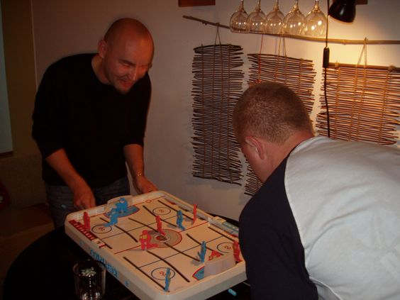Andre and Jeff playing table hockey at their home where we were invited for dinner. Andre won!
