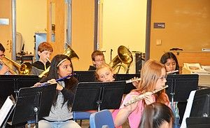 Craig Middle School sixth-grader Delilah Perez watches for cues from Band Director John Bolton as she and the other students prepare for a concert scheduled for 7 p.m. Thursday in the high school auditorium.