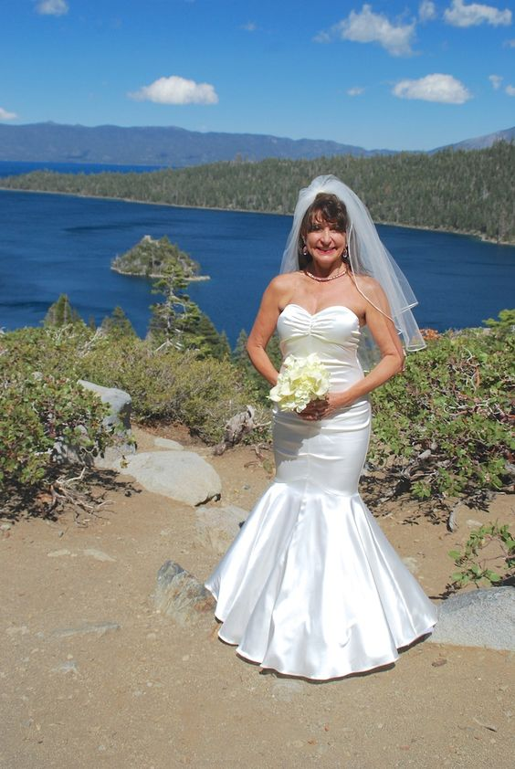 """Beautiful bride at a beautiful Lake Tahoe wedding venue.  Get married at Emerald Bay, perched above the crystal blue as you says """"I do."""" #laketahoeweddingvenues #weddingsinlaketahoe #emeraldbayweddings"""
