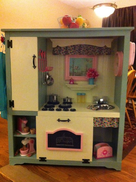 Entertainment center upcycled into little girl 39 s dream for Upcycled entertainment center