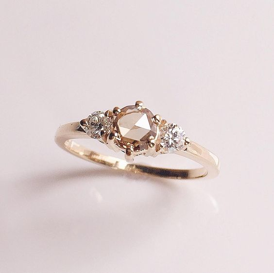 Like clear pools, our Tidals Ring set with a rose cut champagne diamond and…