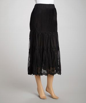 Set to sway with every step, this skirt features tiny pleats that lead to a sweeping lace overlay.