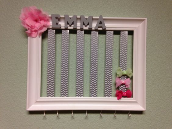 Easy Diy bow hanger for less than $20! Got the white frame from Joanne's on sale and with coupon, bought the chevron ribbon at Hobby Lobby during their ribbon sales and the hooks were $3 at Walmart - just spray painted them white. The letters and bows were together $5. So easy, just glued everything together and screwed in hooks once the paint dried! Ta Da! Easy baby shower gift. Cheap baby gift. Diy bow hanger!