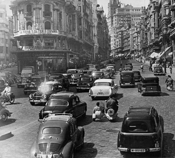 La Gran Vía, Madrid, 1956. Look at the white Cadillack at the center of the street. My second car was one like this.