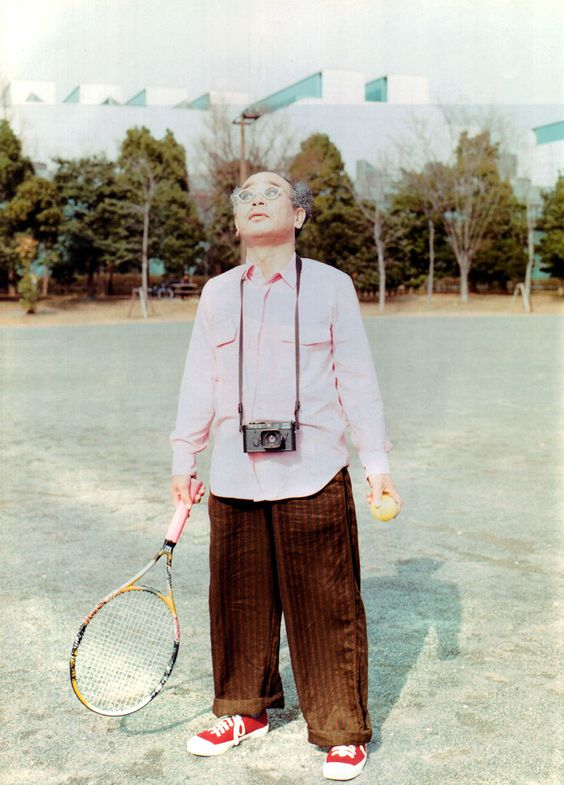 Nobuyoshi Araki modeling COMME des GARCONS.From a fashion spread in the April 1999 issue of Switch magazine Photo by Masafumi Sanai