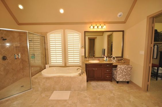Ceramic tile surround in the tub and shower. Separate sink areas with plenty of counter space.