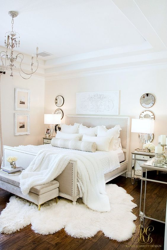 Neutral white autumn master bedroom suite with faux fur, mirrored furniture, and cozy lighting. 3 Days of Halloween - Glam Halloween Home Tour - Randi Garrett Design