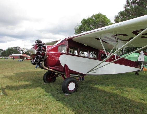 Sturdy Stance by PIX-R-US with AircraftCloudsGrassAirportAntiqueMonoplane