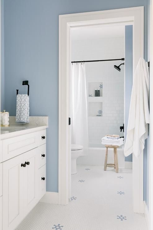 Welcoming White And Blue Bathroom Features White Hex Floor Tiles Accented With Blue Penny Tiles Complementing B Blue Bathroom Blue Penny Tile Bathrooms Remodel