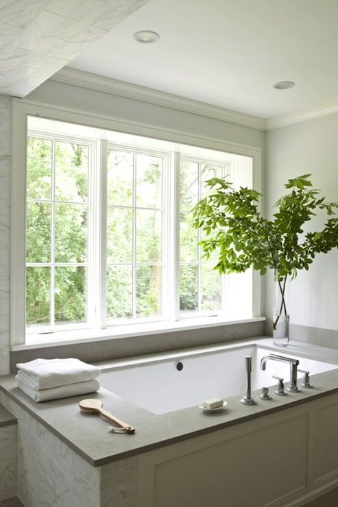 Milton development gorgeous master bathroom with blue for Master bathroom window ideas