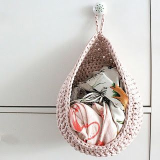 hanging basket-reminds me of diaper holders..which would be good for towels etc