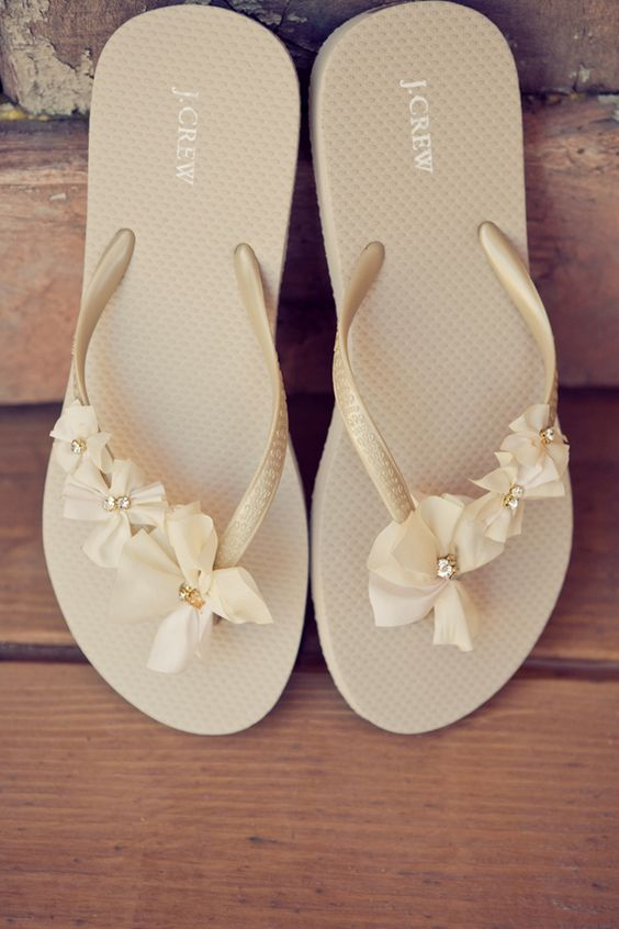 dress up some inexpensive flip-flops to turn them into after wedding bridal shoes. Cute, comfortable, and cheap.