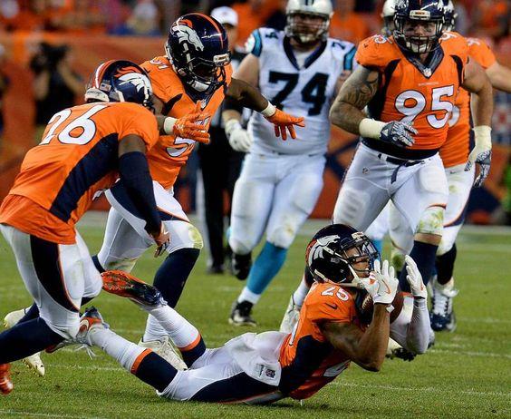 Denver Broncos cornerback Chris Harris Jr., intercepts a pass by Carolina…