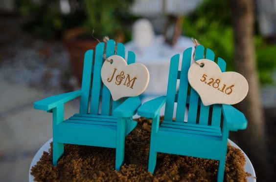 Love this cake topper for Jeremy & Melissa' wedding. #simpleweddingsflorida