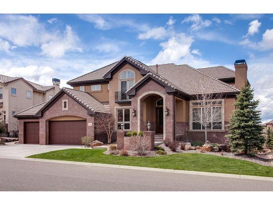 Gorgeous custom home with stucco and brick exterior for Custom brick homes