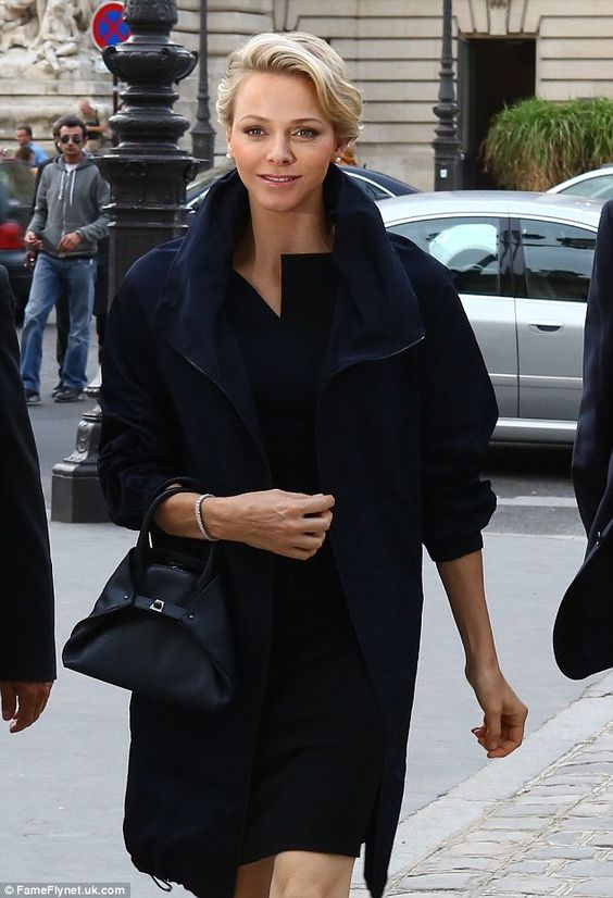 Princess Charlene donned an on-trend structured Little Black Dress and overcoat
