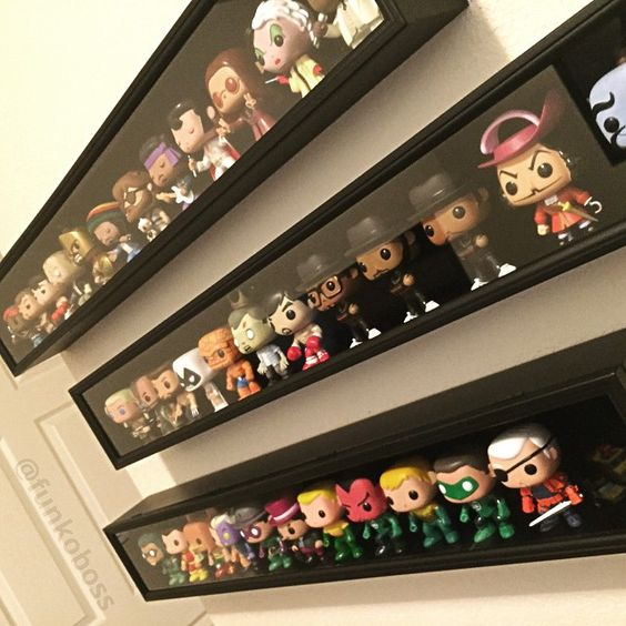 What an awesome way to display Funko figures - baseball bat cases screwed to the wall!