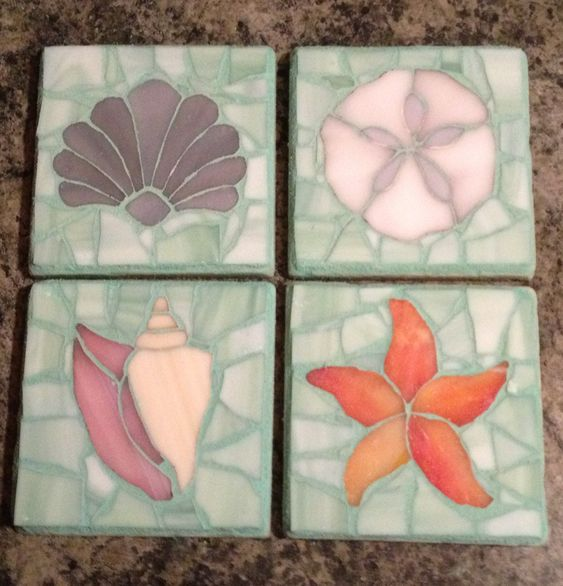 Mosaic stained glass coasters. Made for a beach house so I used patterns for a clam shell, conch shell, starfish, and sand dollar. I glued felt in the bottom to protect surfaces and the tops are sealed against water.