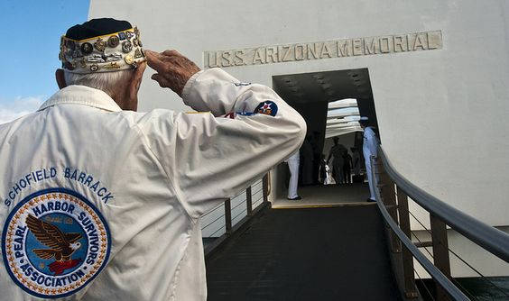 A Pearl Harbor survivor, salutes the Arizona memorial during a wreath laying ceremony at Joint Base Pearl Harbor-Hickam. by Official U.S. Navy Imagery, via Flickr