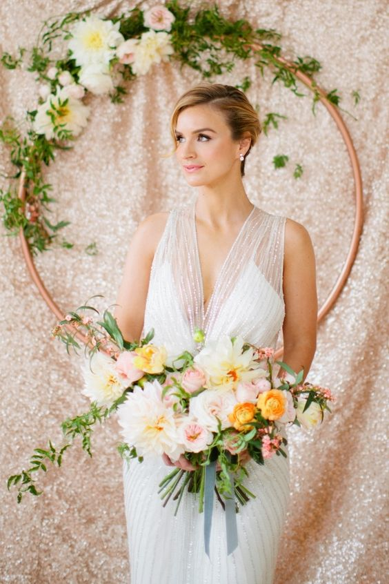 Vintage Glam Jenny Packham Wedding Dress in Front of Sequin Backdrop | Betsi Ewing Studio on @loveincmag via @aislesociety: