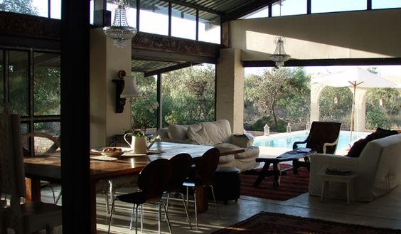 Natural light streams through many glass doors and windows in the main living area