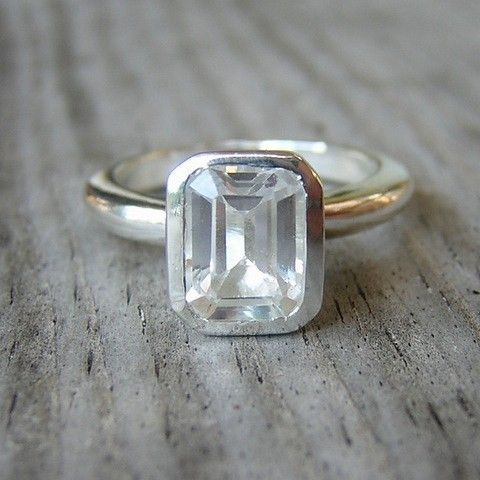 White topaz emerald cut ring.