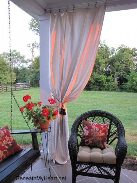 Drop cloth patio curtains - great, inexpensive idea!!  Could even add a little trim to spruce it up a bit.