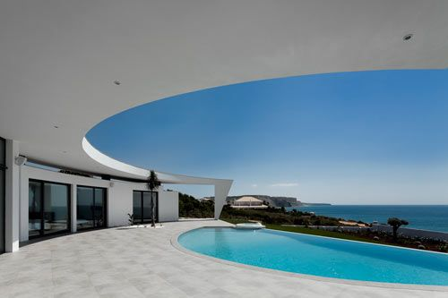 Mmmm - I wanna lay out by this pool!  :)  Love the architecture too!