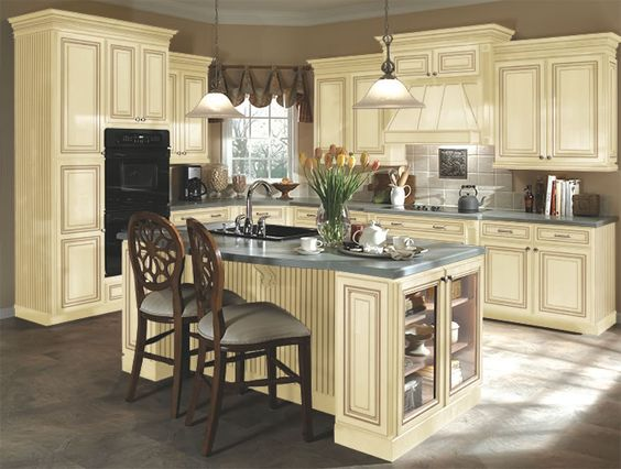 Kitchen idea #3: distressed cream cabinets, this has tile but I ...