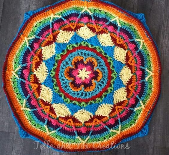 Damn that was a tedious round of bp crochets lol but I'm sad to say this is the last photo before work again lol also the last photo of my Sophie as a circle it's slowly becoming a square  #crochet #crochetaddict #yarn #yarnporn #sophiesuniverse #crochetmandala #crochetalong #sophiesuniversecal #etsy #crochetblanket #mandala #rainbow by tellaandfoxcreations