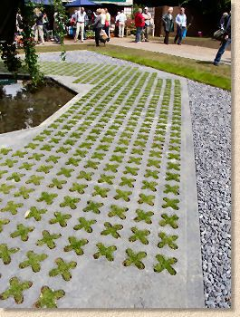 Grass & Concrete. Looks like cross stitch!