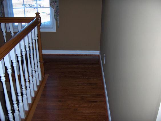 ... hardwood installed in second floor hallway by home based carpet
